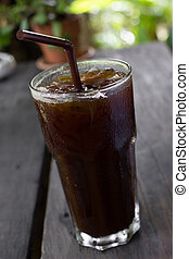 Ice black coffee on wooden table - Delicious ice coffee...