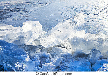 ice blocks on the edge of clearing in frozen river