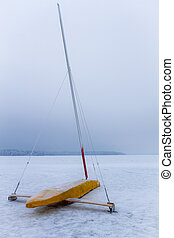 Ice boat on frozen lake at winter