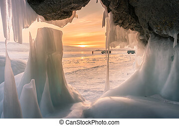 Ice cave with sunset background, Baikal Siberia Russia ...