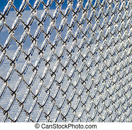 Ice coated chain link fence from an ice storm - Ice covered...
