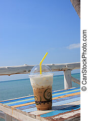Ice coffee by the sea and sky