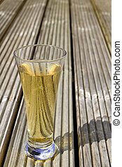 Ice cold beer on wooden decking