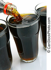 Ice Cold Cola - Glasses of cola isolated against a white...