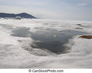 Ice-covered Lake Baikal. Spring.