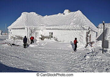 An ice-covered meteorological station, high on a mountain-top