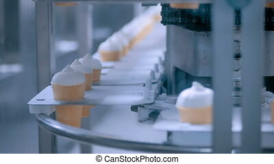 Ice cream automatic production line at modern food dairy...