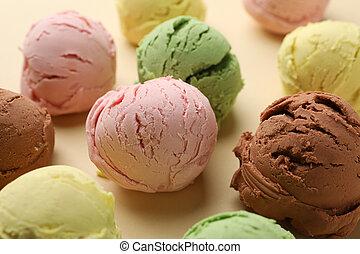 Ice cream balls on beige background, close up