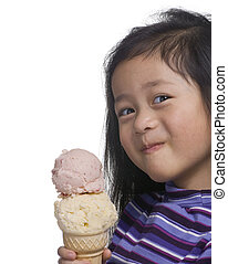Ice Cream Cone - A young asian girl enjoying a large ice...