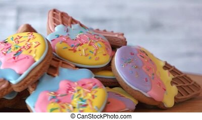 Ice cream cone cookies with colorful frosting. Tasty cut out...