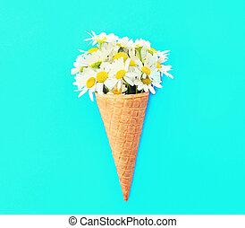 Ice cream cone with chamomiles flowers
