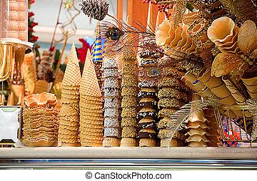 Lots of beautiful ice cream cones in closeup