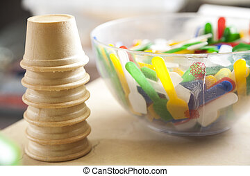 Ice Cream Cups By Multicolored Spoons In Bowl