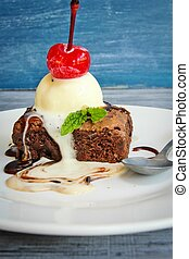 Ice cream on brownie with cherry