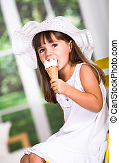 ice cream - young girl eating an ice cream