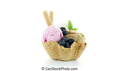 Ice cream scoops in wafer bowl on white background