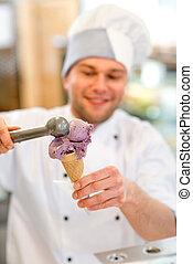 Ice cream seller - Confectioner putting ice cream to the...