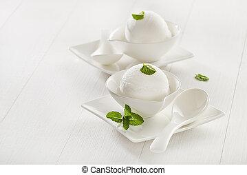 Ice cream - sorbet - Fresh white ice cream in a white cup.
