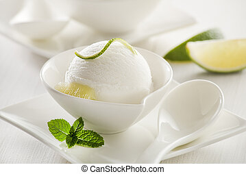 Ice cream - Fresh lemon and lime ice cream in a white cup.
