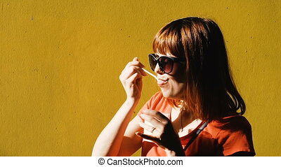 Ice cream. The girl eats ice cream