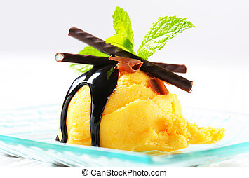 Ice cream with chocolate sauce and mint sticks