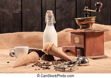 Ice cream with coffee beans, milk and a coffee mill: Selective focus