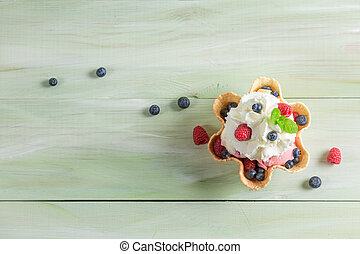 Ice cream with fresh berry fruits