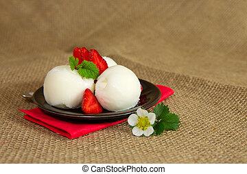 Ice cream with strawberry .