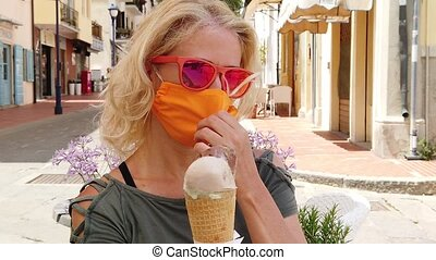 ice cream with surgical mask - SLOW MOTION: tourist woman ...
