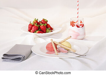 Ice cream with tube wafers and whipped cream dessert: food concept.