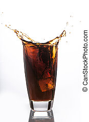 Ice cube falling into glass of soda on white background