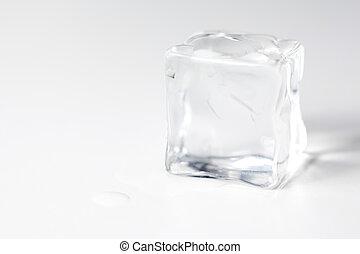 ice cube isolated - translucent ice cube isolated over white...