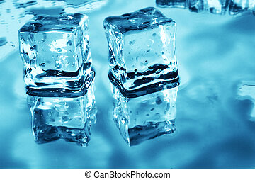 Ice Cubes - Blue toned ice cubes on reflective surface
