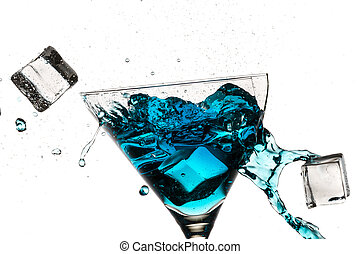 Ice cubes breaking martini glass filled with blue liqueur on white background