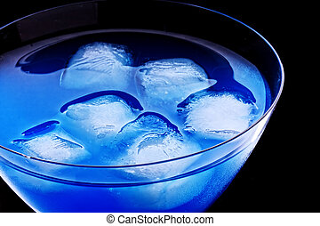 Ice cubes in blue cocktail