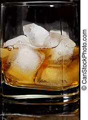 Ice cubes in whiskey
