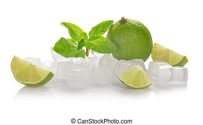 Ice cubes, lime, mint and the slices of a lime isolated on...