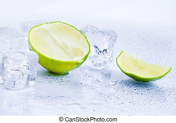 Ice cubes with fresh lime isolated on white