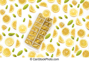 Ice cubes with lemons on white background
