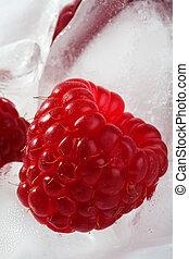 Ice cubes with raspberries