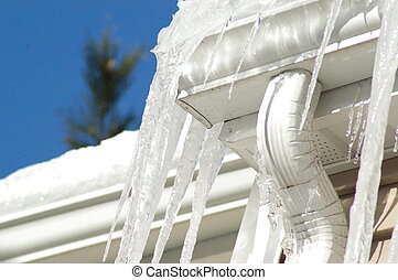 Ice Dams - Icicles and ice form around a downspout