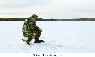Ice Fishing Fail - man fishing on the lake, strike, but...