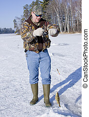 ice fishing on a freshwater lake with fish on the line