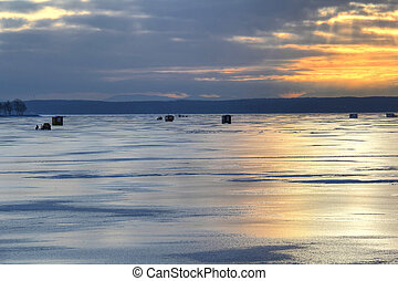 Early morning view of ice fishing huts on Lake Champlain