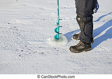 Ice Fishing - Ice auger - tool is for drilling fishing hole...