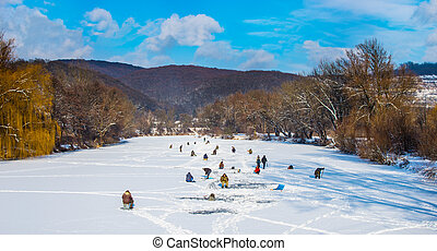 Ice fishing on a frozen river