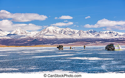 Ice Fishing on Lake Hovsgol . Mongolia