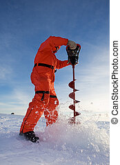 Ice fishing - Ice fisherman drilling a hole with a power...