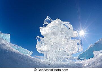 Ice floe crystal and sun over winter Baikal lake