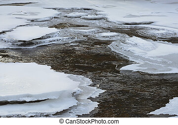 Ice fragments of frozen river water. Natural background
